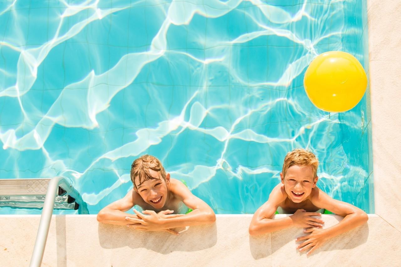 Boys playing in swimming pool