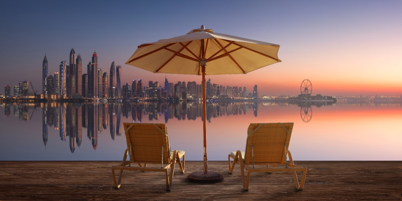 Beautiful beach in Dubai with the skyline of Dubai Marina on the horizon