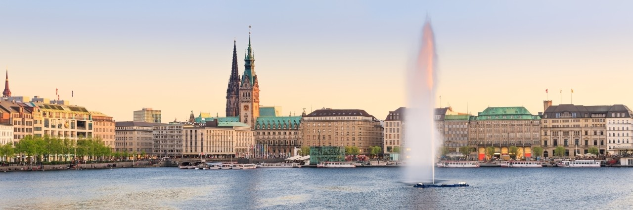 The Lake Binnenalster in Hamburg in Germany during spring time. In the foreground the famous Alster Lake fountain.