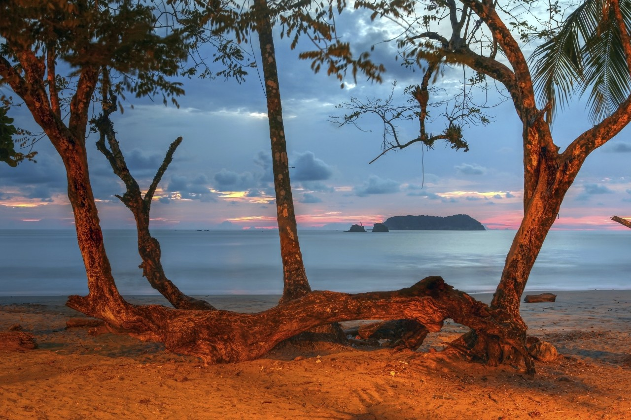 The Playa Espadilla Norte (beach), just outside the Manuel Antonio National Park in Costa Rica at sunset.