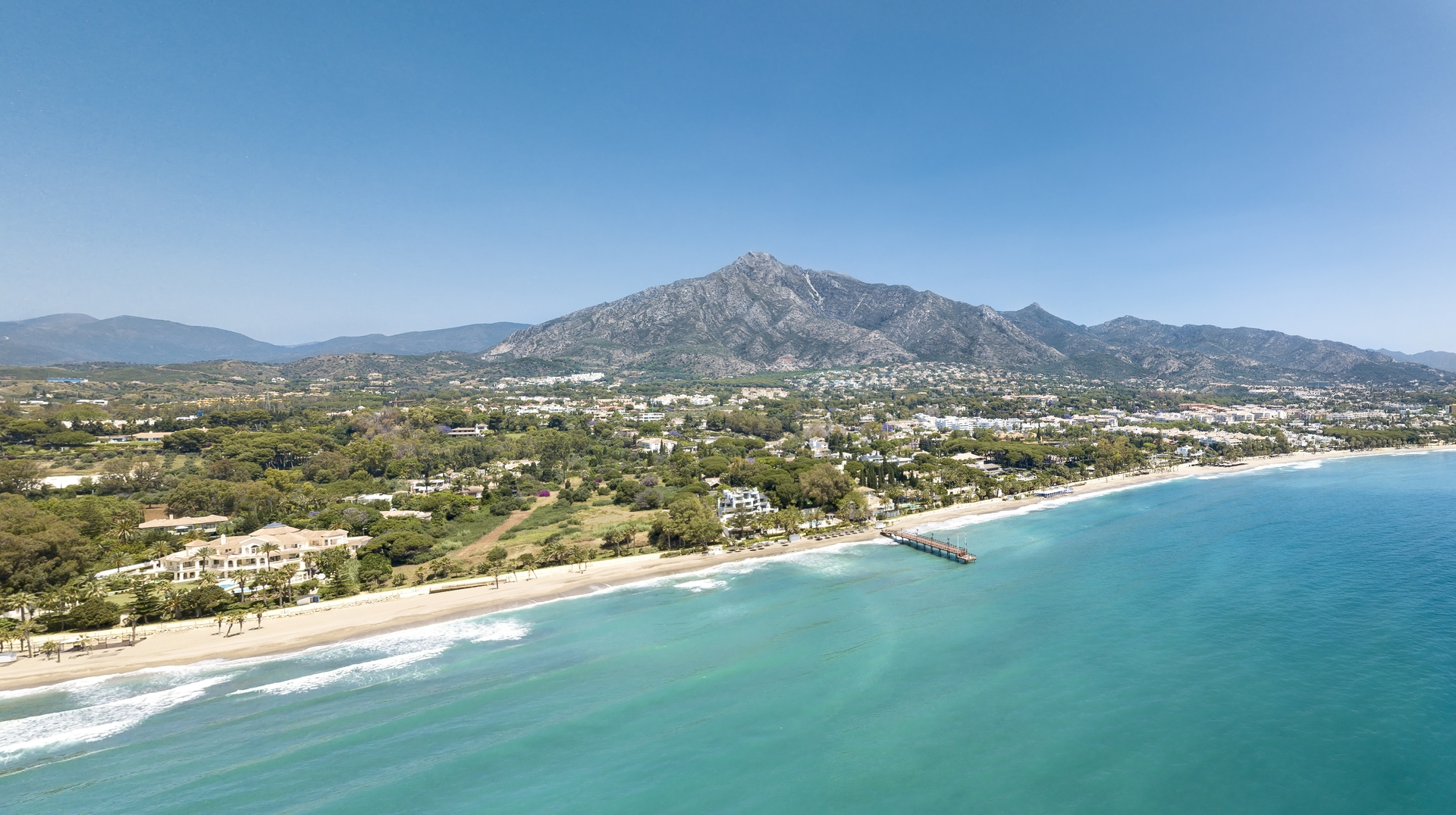 Panoramic aerial view of Casablanca  and Puente Romano beach Marbella, Famous destination with luxury proprieties and restaurants. View of  wood bridge Puente Romano and mountain La Concha.