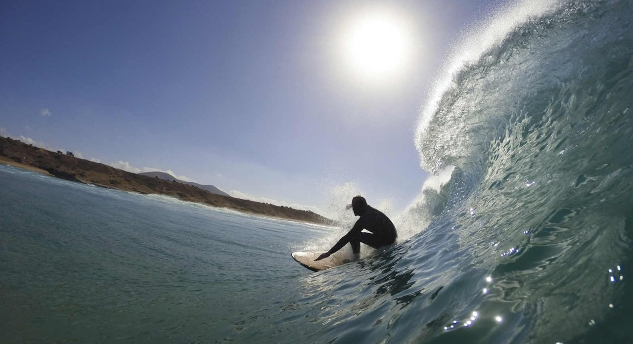 surfer in the tube of a wave