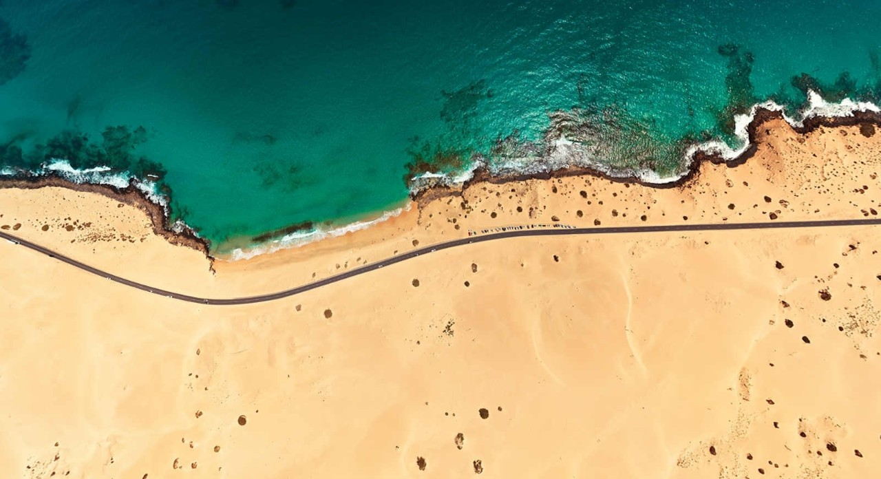 Top aerial view of Corralejo Park coast, Fuerteventura, Spain
