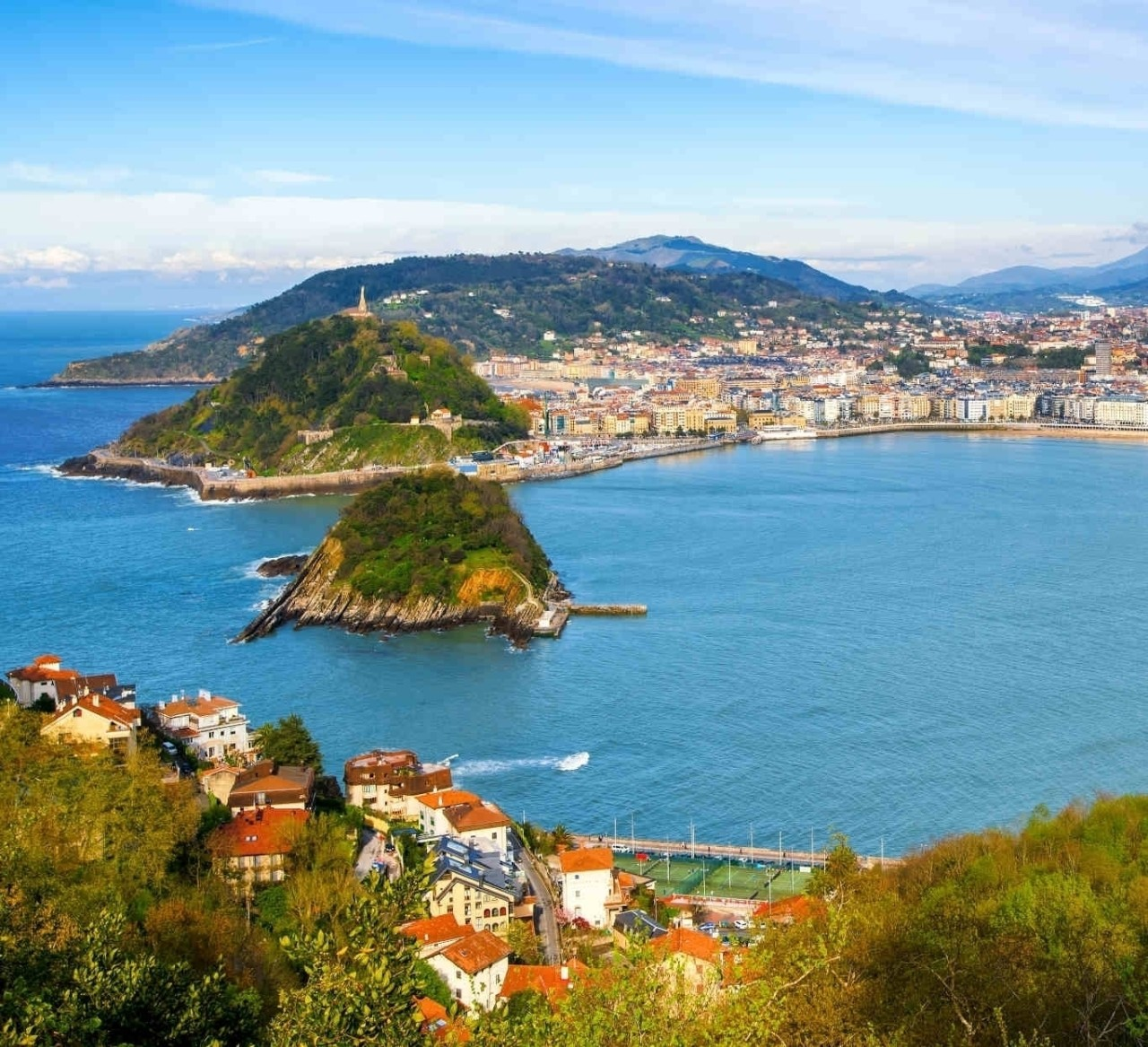 San Sebastian - Donostia city, Basque country, Spain, panoramic view with La Concha bay, Pyrenees mountains and Atlantic ocean