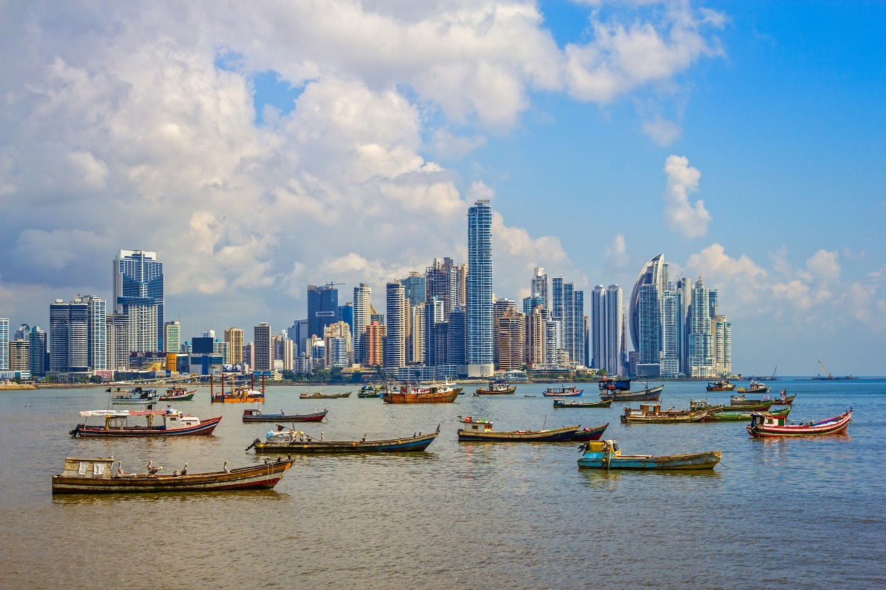 Photo of the skyline of Panama City and harbor with many fishing boats in the Republic of Panama.