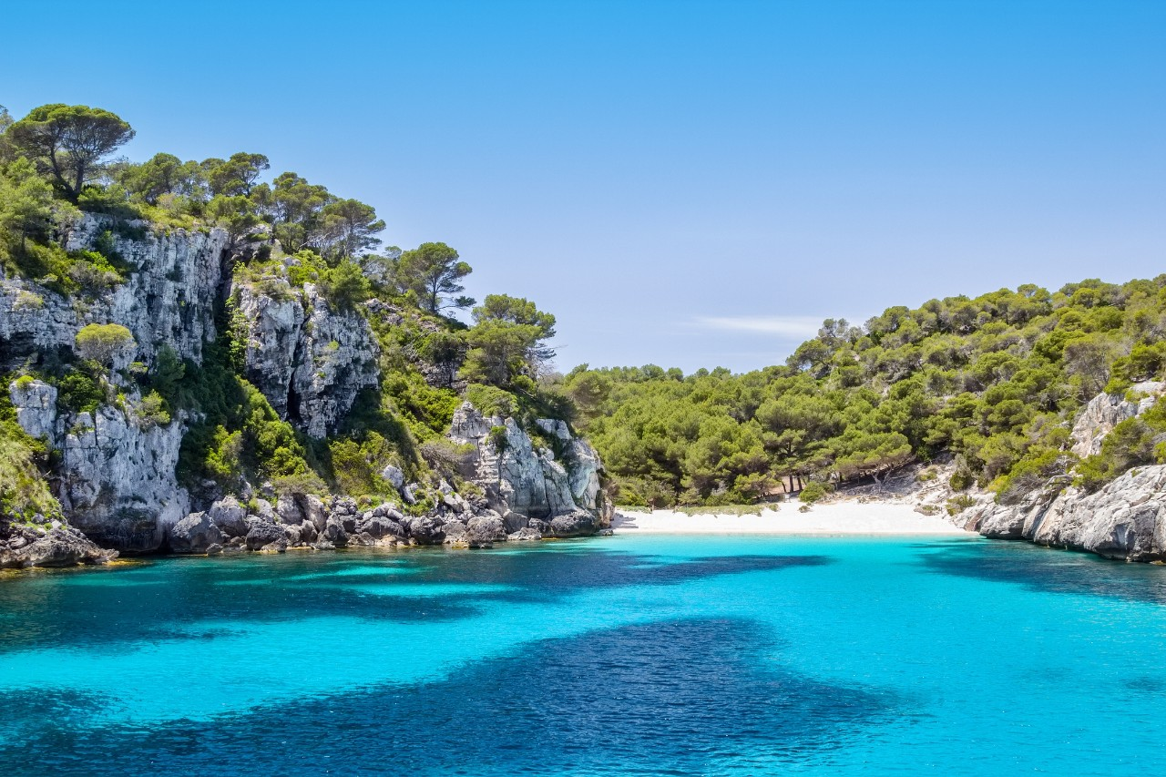 Cala Macarelleta - one of the most popular natural beaches of Menorca Island, Spain